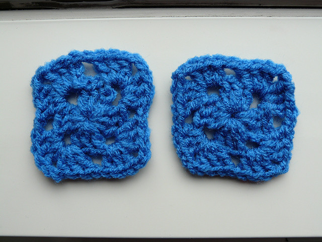 two blue crochet squares