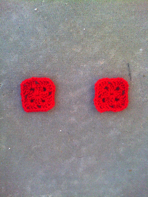 """Two cherry red two-round granny squares born of the thought experiment """"If Josef Albers crocheted"""""""