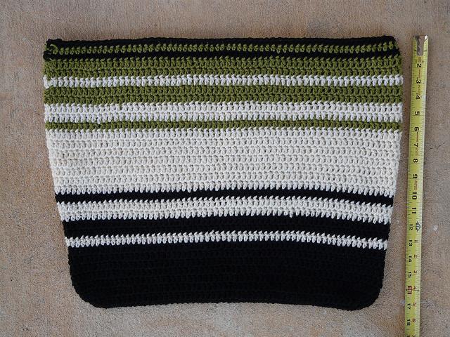 A wool crochet bag seventeen inches deep before felting