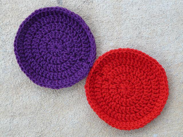 two large crochet circles aka a purple crochet dot and a red crochet dot