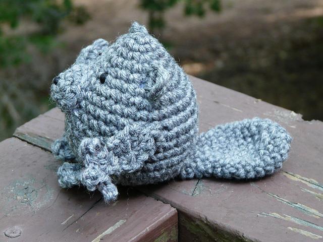 an amigurumi porcupine in need of yarn quills