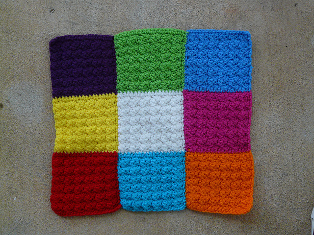 crochet strips joined into a square for a pet mat