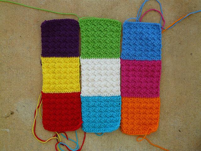 three crochet strips for a crochet pet mat