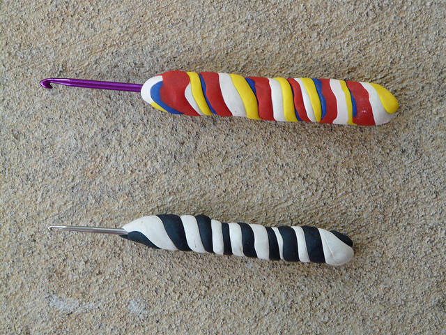 two crochet hooks with polymer clay handles