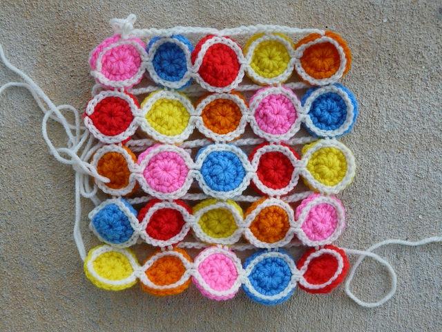crochetbug, crochet circles, join as you go, crochet tote, crochet purse, rainbow is a color