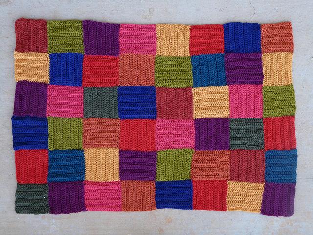 crochet squares repurposed from crochet sweater to crochet pet mat
