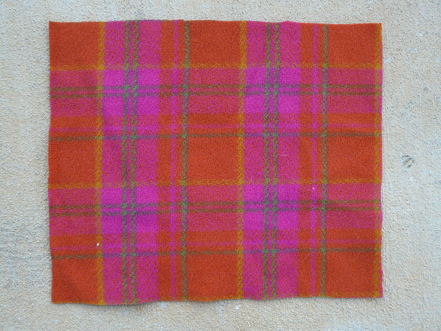 Orange, pink, yellow, green, and periwinkle plaid wool fabric