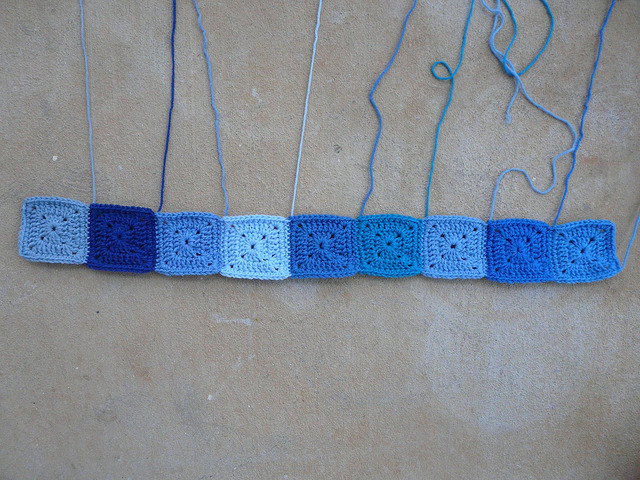I begin piecing the blues crochet squares together