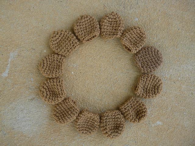 A dozen crochet chair leg socks that were part of the day's crochet hodge podge