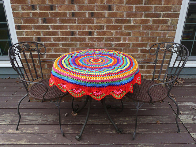 My outdoor office work table with the recently completed african beads table cozy