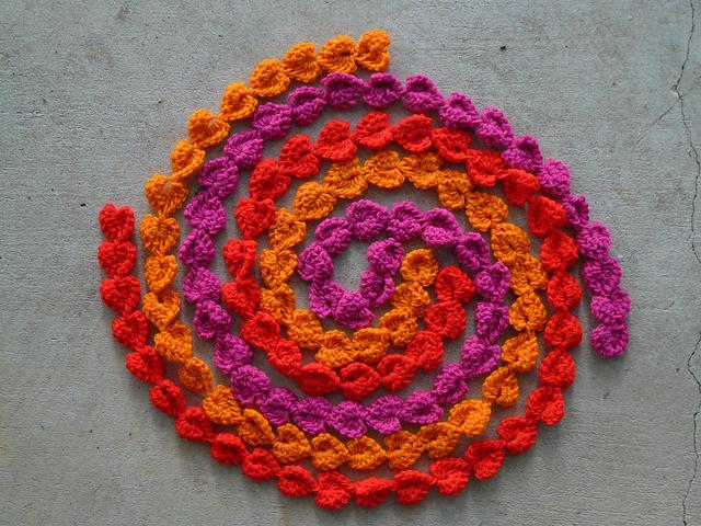 three strands of crochet hearts