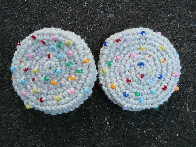 Two crochet sugar cookies