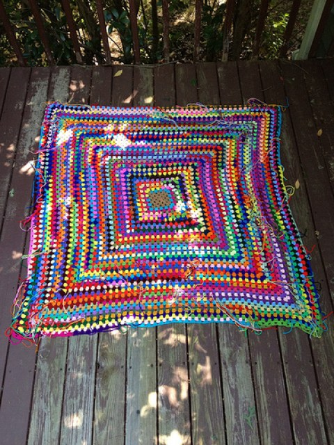 A great granny square made with many (many) yarn scraps