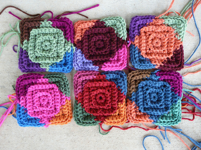 Six multicolor crochet squares that are part of the motif madness