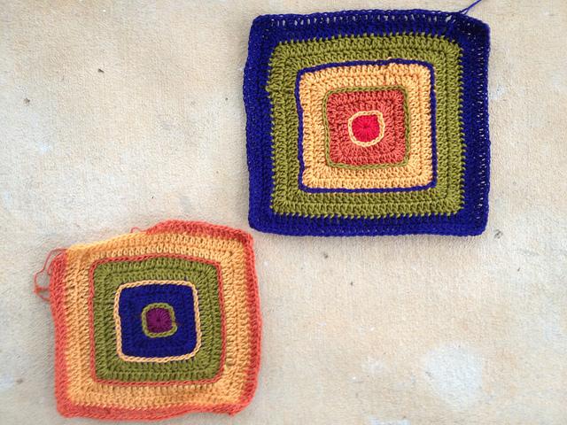 Two multicolor rainbow crochet potholders ready for felting