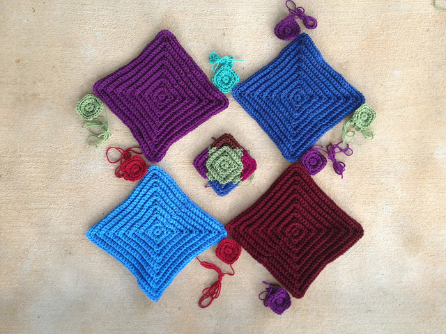 eight small textured crochet squares