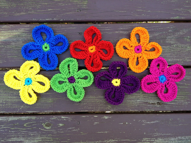 Seven Hawaiian crochet flowers that are another element of my motif madness