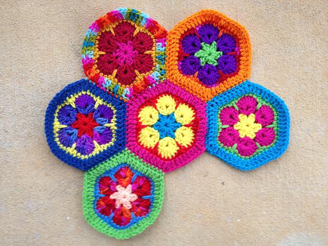 six multicolor crochet african flower hexagons