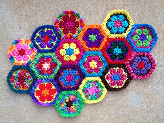 Seventeen African flower crochet squares joined with a whipstitch