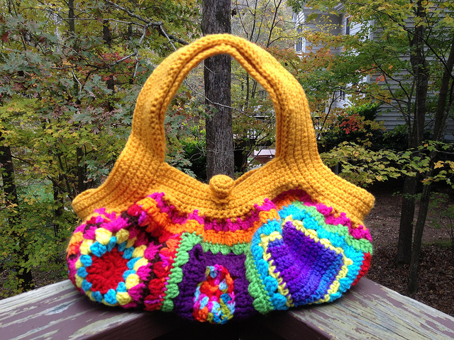 A multicolor, fabric lined granny square fat bag
