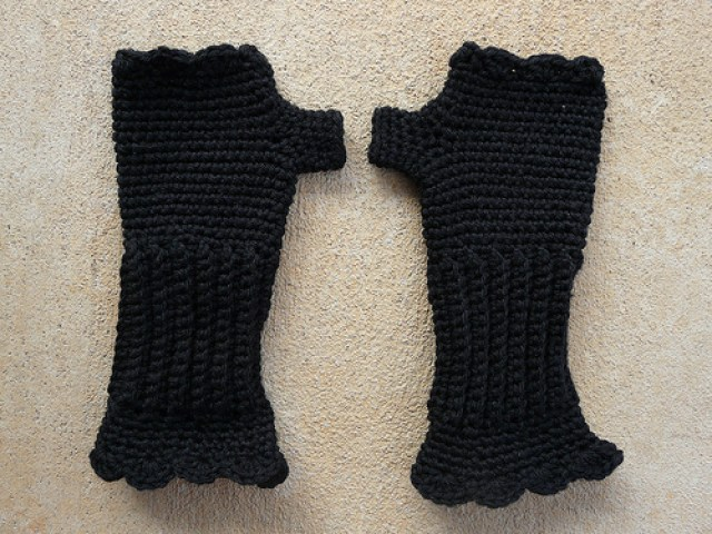 black fingerless crochet gloves made from vintage yarn