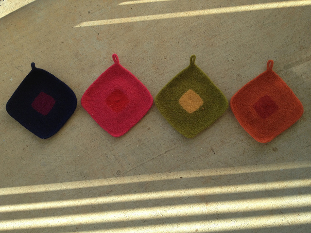 Four felted crochet potholders for Josef Albers in shadow and sunshine ready to change my life in the kitchen