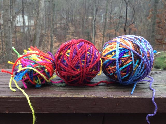 Three scrap yarn balls