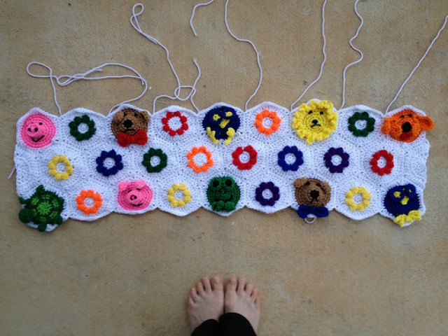 I finish joining three rows of crochet hexagons for a crochet blanket