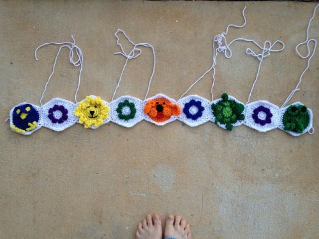 a row of crochet hexagons for a crochet blanket