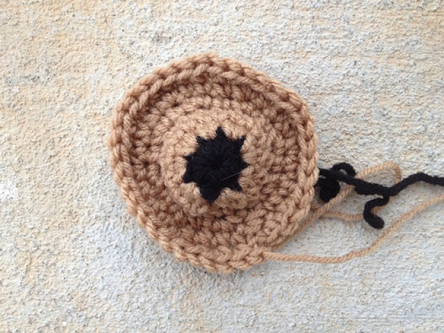 A crochet bear face for a crochet hexagon