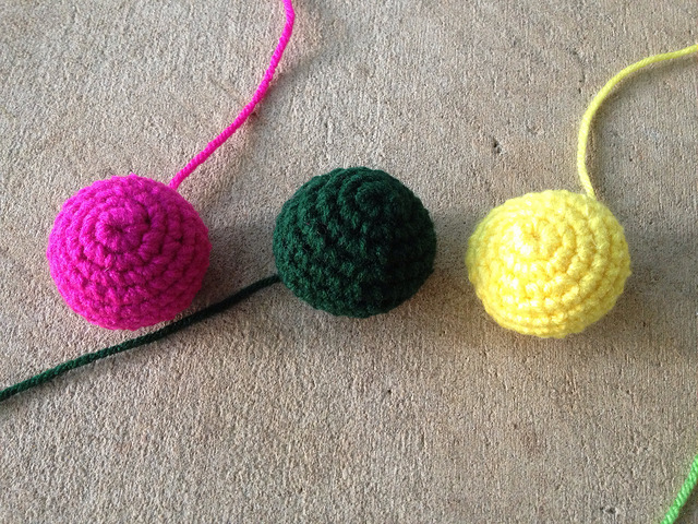 three crochet balls to decorate a crochet purse on April 28