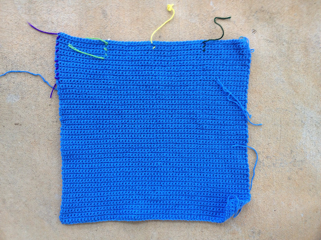 seventy-two rows of single crochet for the blue center panel of a crochet blanket