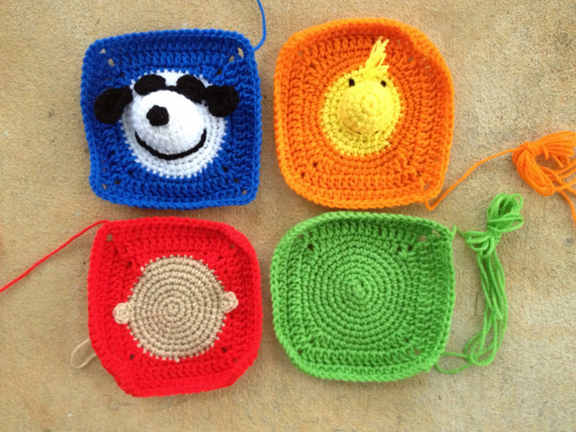 Four crochet squares for a project linus crochet blanket