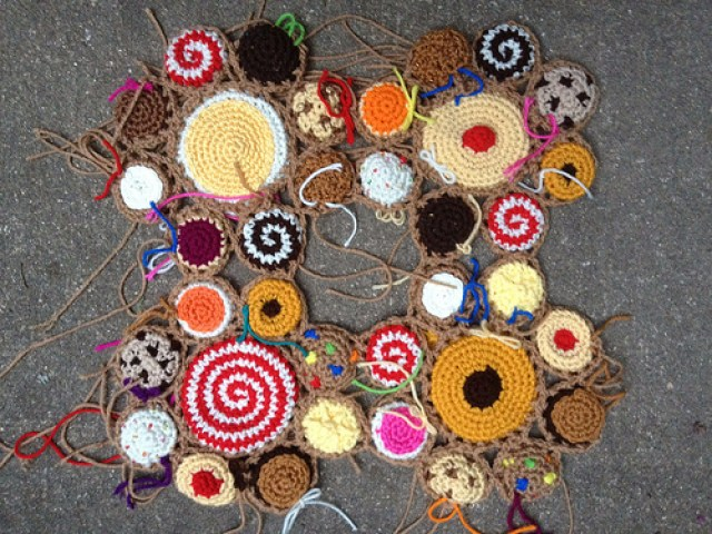 four cookie crochet motifs