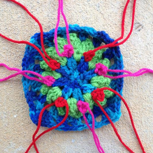 Crochet wreath granny square with crochet berries
