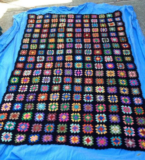 A granny square blanket made by Beth and Polly, crochetbug, granny squares, crochet squares, scrap yarn crochet, granny square blanket, granny square afghan, granny square throw