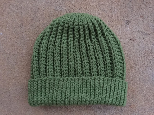 A tealeaf seafarer's crochet cap, ready to wear; the fifth of five caps
