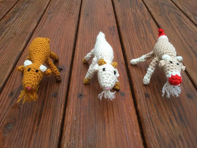 Three amigurumi goats