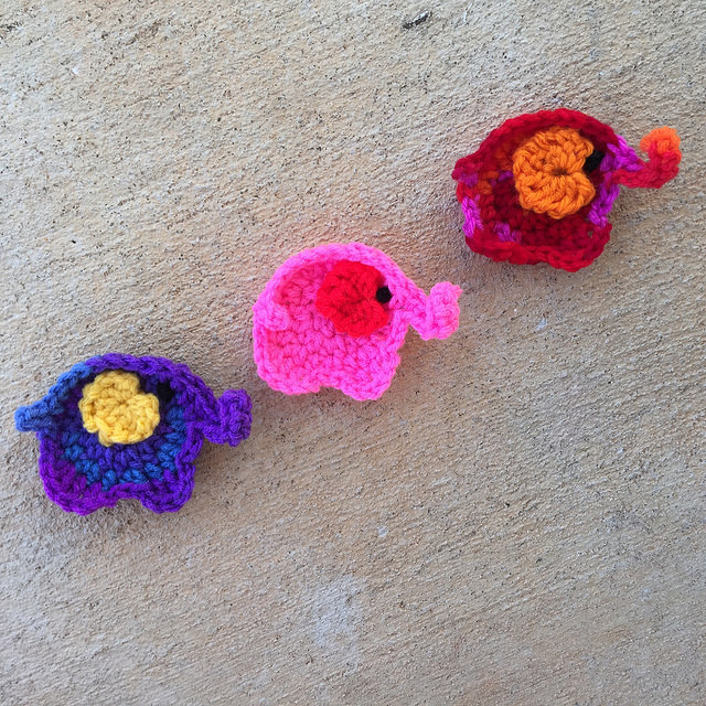 three crochet elephants on parade