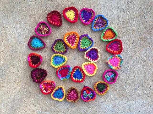 a circle of boho crochet hearts