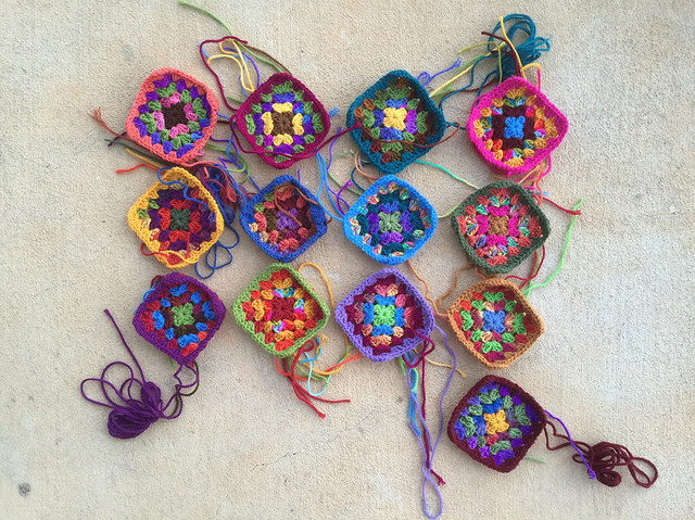 A grand total to thirteen granny squares for a granny square purse