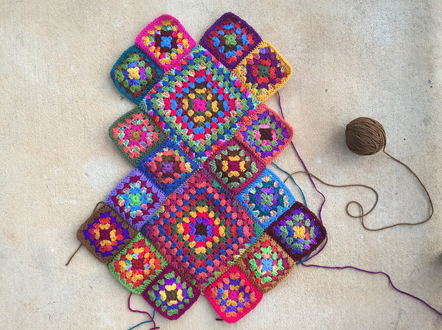 Seaming the granny square bag to-be as the piecing begins in earnest