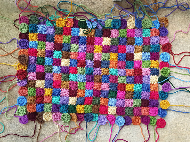 granny squares for the clock panel with much of the piecing done