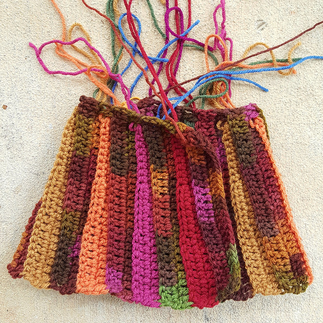 the skirt of a crochet baby sweater