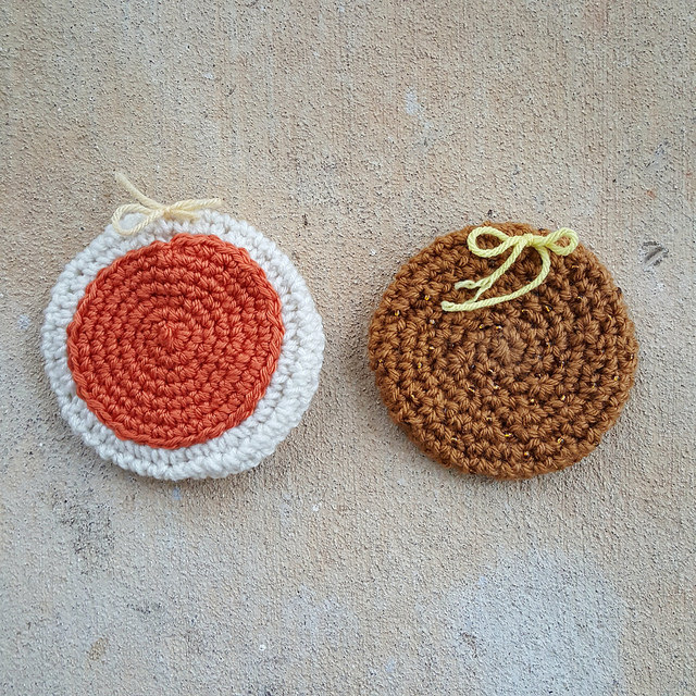 two crochet cookies for a crochet scarf