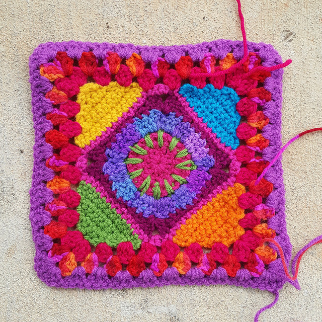 multicolor crochet granny square with ends to be woven in