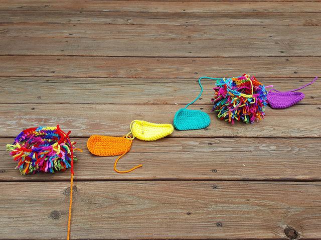 six scrap yarn crochet cats