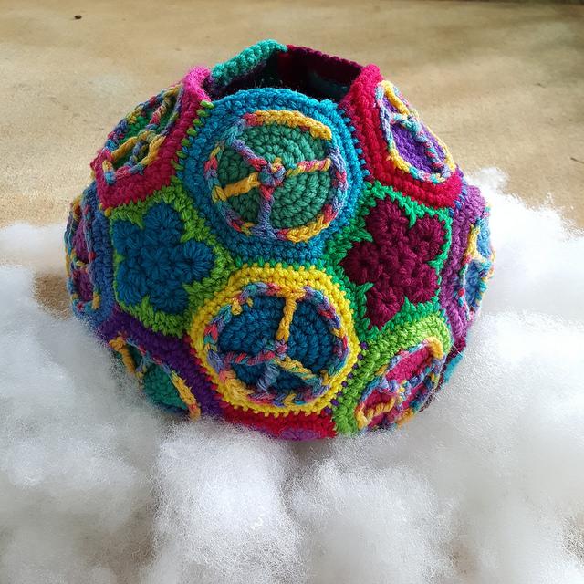 Crochet hexagons and crochet pentagons for a peace sign and flower crochet soccer ball