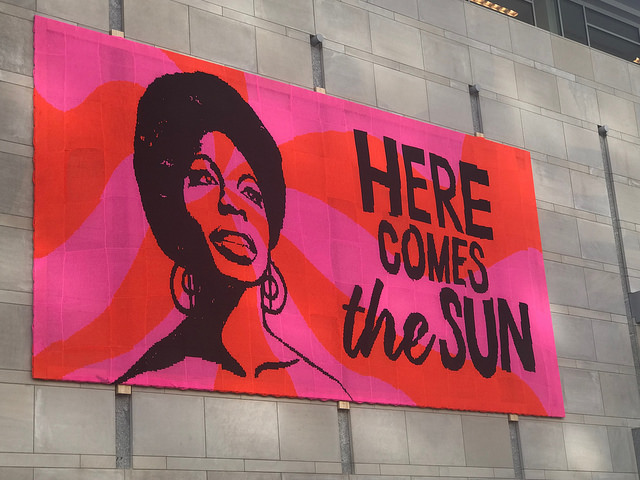 """Nina Simone """"Here comes the sun"""" crochet poster at the Raleigh Convention Center"""