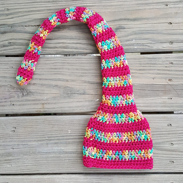 A munchkin hat in need of a pom pom for a baby's first crochet on the life-time continuum